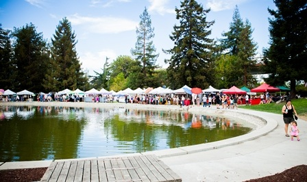 Art and Wine Festival booths surrounding pond