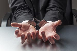 Handcuffs for Businessman Going to Jail from the Workplace