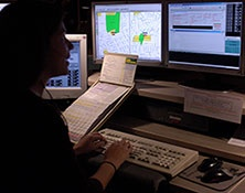image of dispatch personnel handling a call at Communications center