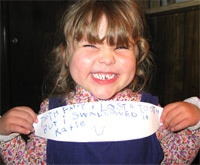 About: Child with Tooth Fairy Sign