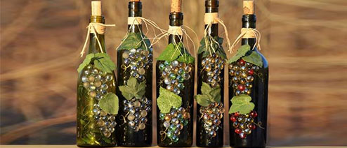 4 decorated wine bottles